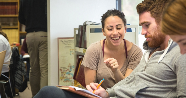 Photograph of an intro couple learning together