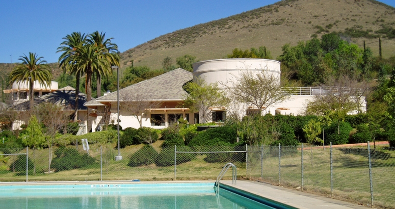 Image of swimming pool and cottages at Brandeis Bardin campus in Simi Valley