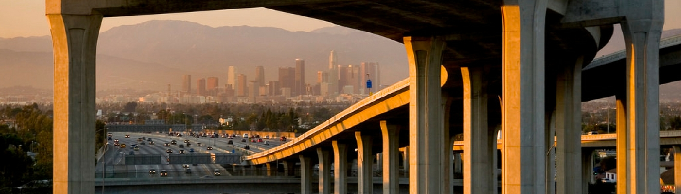 Image of Los Angeles Downtown skyscape in distance over freeway