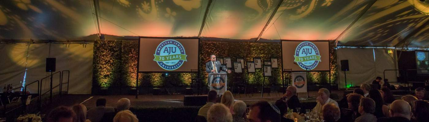 Photo of Dr. Robert Wexler speaking at AJU's 70th Anniversary dinner
