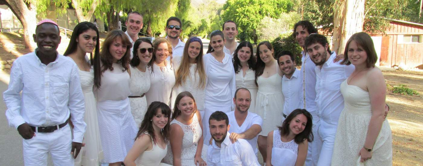 Photograph of a group of BCI attendees dressed in white