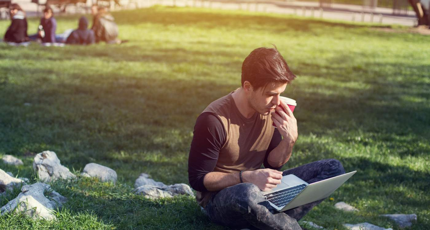 Photograph of Student on Campus Lawn