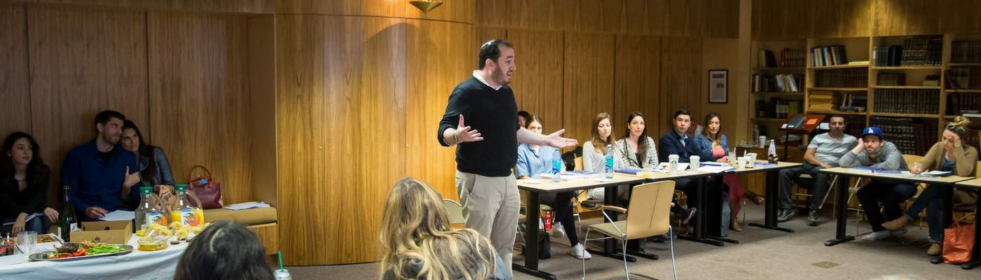 Photograph of classroom with instructor speaking to students