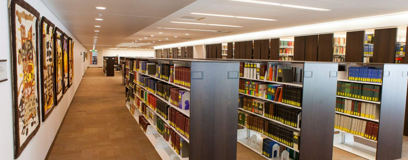 Photograph of book stacks in the Ostrow library