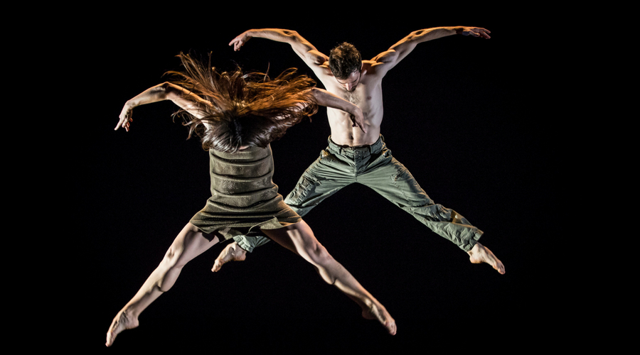 Image of 2 dancers jumping into air as part of Rachel to Jacob