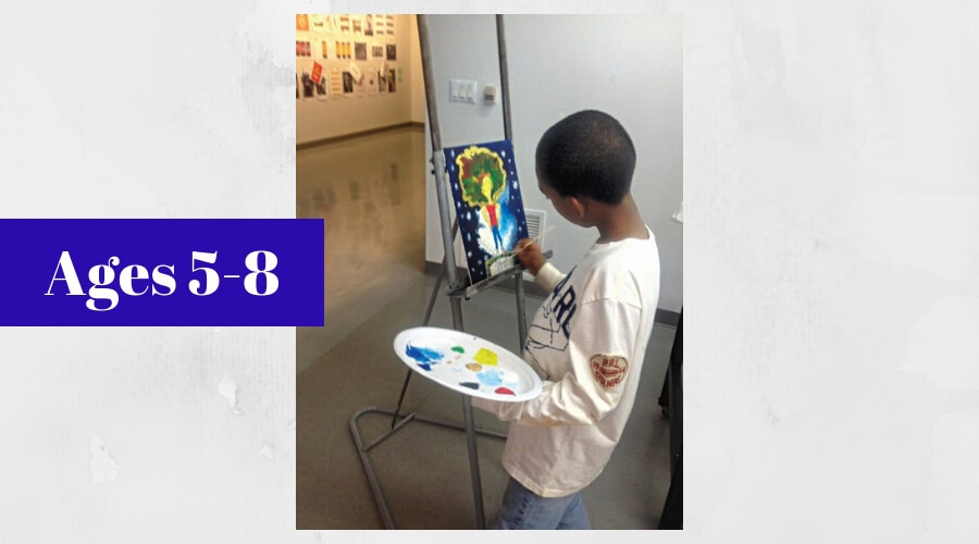 Image of young boy painting