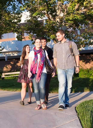 Photograph of students walking through campus