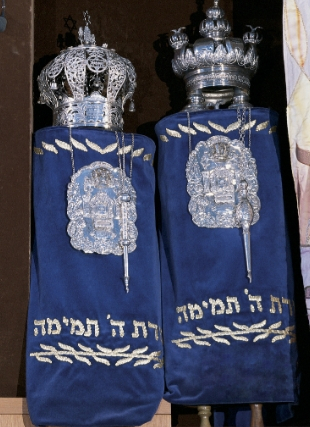 Photo of two blue torah scrolls