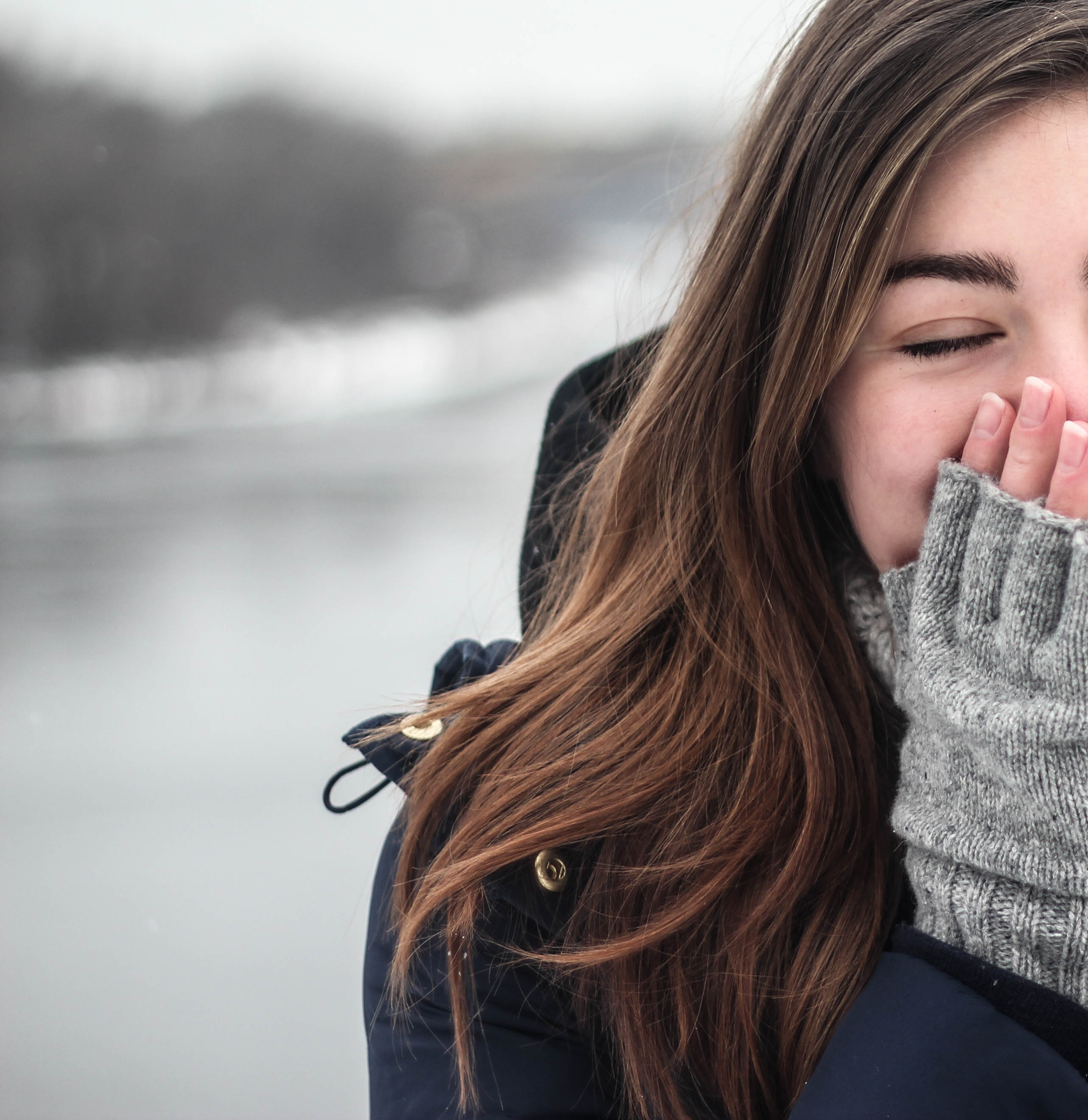 Girl covering face in the snow