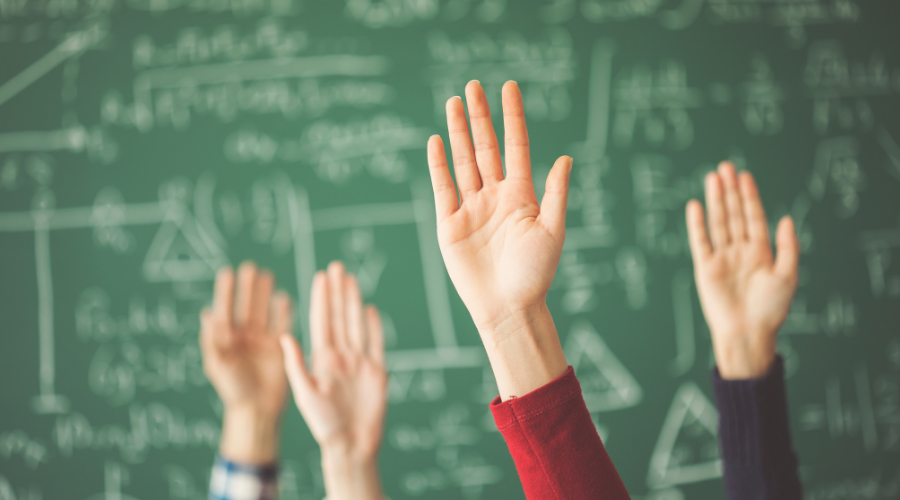 Photo of hands being raised in a class