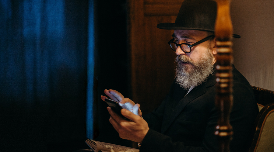 rabbi texting on a cell phone