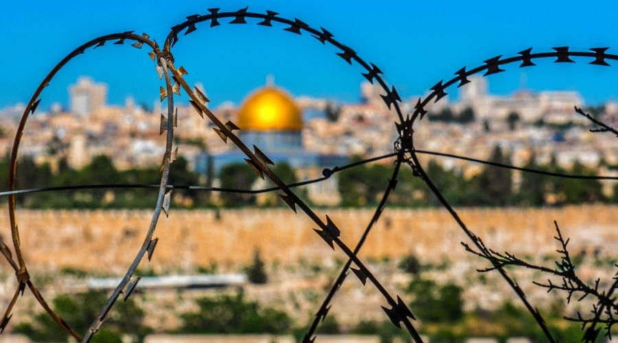 barbed wire with Jerusalem in the background