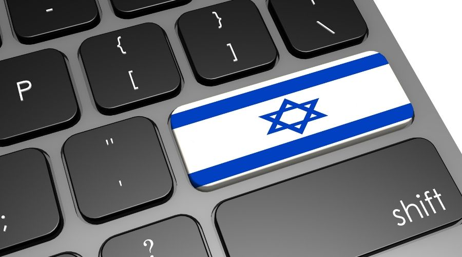 laptop keyboard with the flag of israel on it