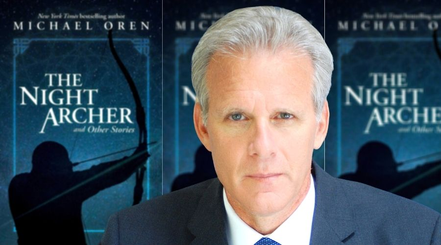 Michael Oren in front of his book cover