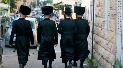 hassidic men walking down the street
