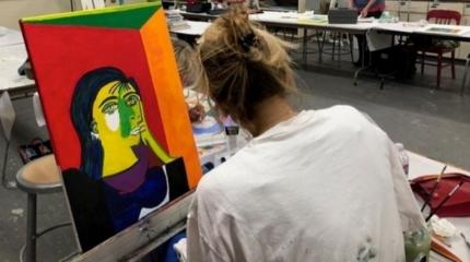 girl painting in a studio